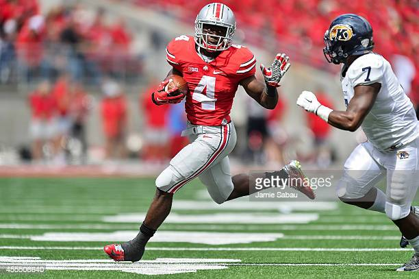 Curtis Samuel of the Ohio State Buckeyes runs with the ball against the Kent State Golden Flashes on September 13 2014 in Columbus Ohio