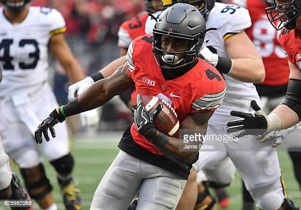 Curtis Samuel of the Ohio State Buckeyes rushes for the gamewinning touchdown in overtime against the Michigan Wolverines at Ohio Stadium on November...