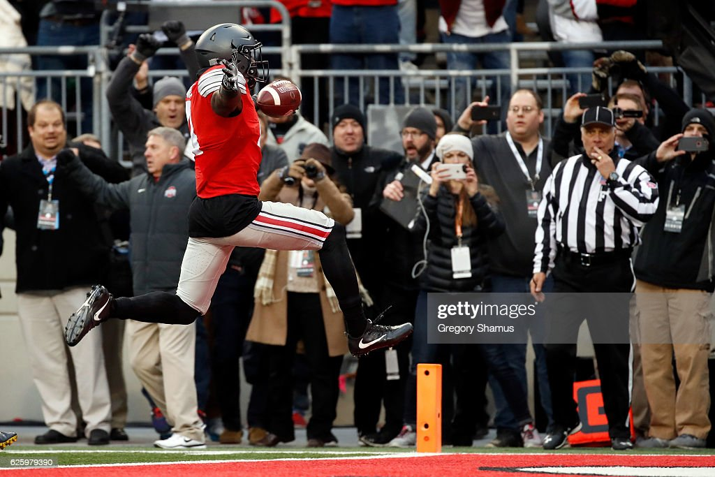 Curtis Samuel #4 of the Ohio State Buckeyes scores the winning touchdown in double overtime against the Michigan Wolverines at Ohio Stadium on November 26, 2016 in Columbus, Ohio.
