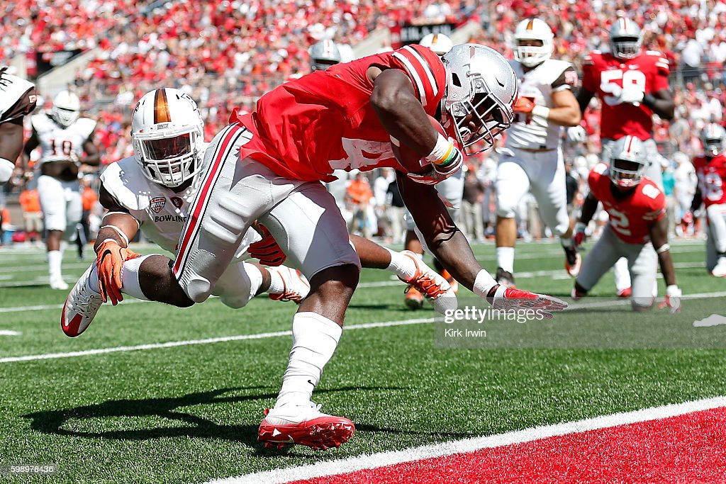 Curtis Samuel #4 of the Ohio State Buckeyes slips past James Sanford #4 of the Bowling Green Falcons to score a touchdown during the third quarter on September 3, 2016 at Ohio Stadium in Columbus, Ohio. Ohio State defeated Bowling Green 77-10.