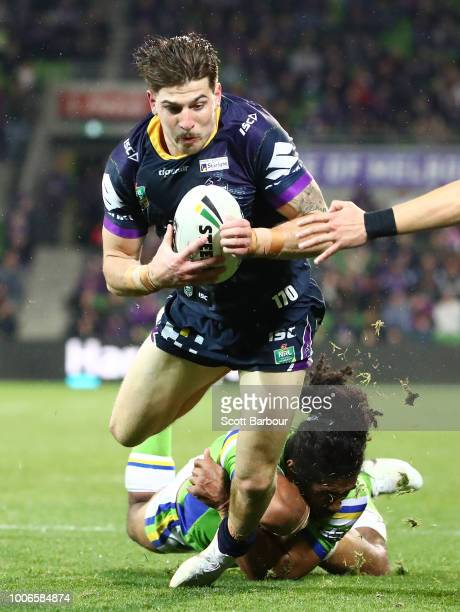 Curtis Scott of the Melbourne Storm scores a try during the round 20 NRL match between the Melbourne Storm and the Canberra Raiders at AAMI Park on...