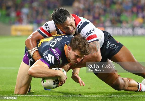 Curtis Scott of the Melbourne Storm scores a try during the round 6 NRL match between the Melbourne Storm and the Sydney Roosters at AAMI Park on...