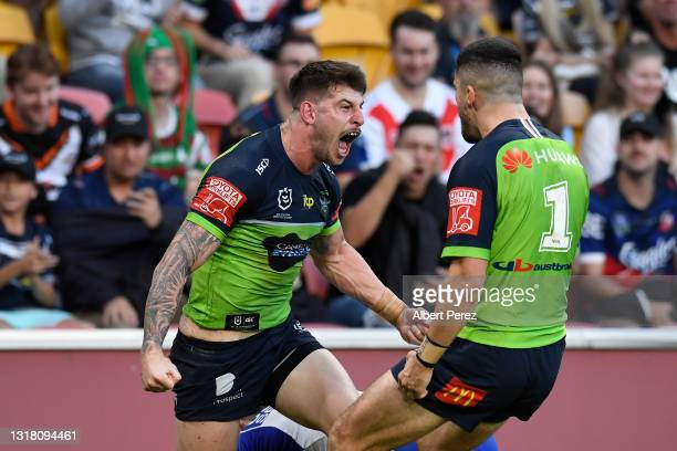 Curtis Scott of the Raiders celebrates with team mates after scoring a try during the round 10 NRL match between the Canterbury Bulldogs and the...