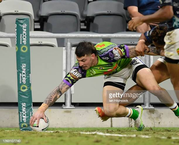 Curtis Scott of the Raiders scores a try during the round 12 NRL match between the North Queensland Cowboys and the Canberra Raiders at QCB Stadium...