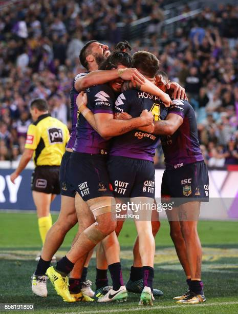 Curtis Scott of the Storm celebrates with team mates after scoring a try during the 2017 NRL Grand Final match between the Melbourne Storm and the...