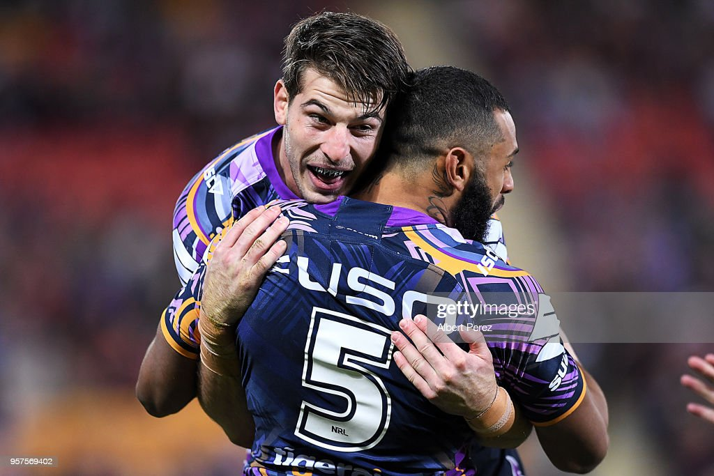 Curtis Scott of the Storm celebrates with team mates after scoring a try during the round ten NRL match between the Melbourne Storm and the Gold Coast Titans at Suncorp Stadium on May 12, 2018 in Brisbane, Australia.