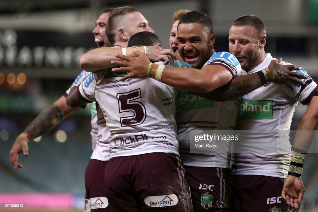 Curtis Sironen, Jackson Hastings, Akuila Uate Daly Cherry-Evans, Dylan Walker and Blake Green of the Sea Eagles celebrate Uate scoring a try during the round nine NRL match between the South Sydney Rabbitohs and the Manly Sea Eagles at Allianz Stadium on April 28, 2017 in Sydney, Australia.
