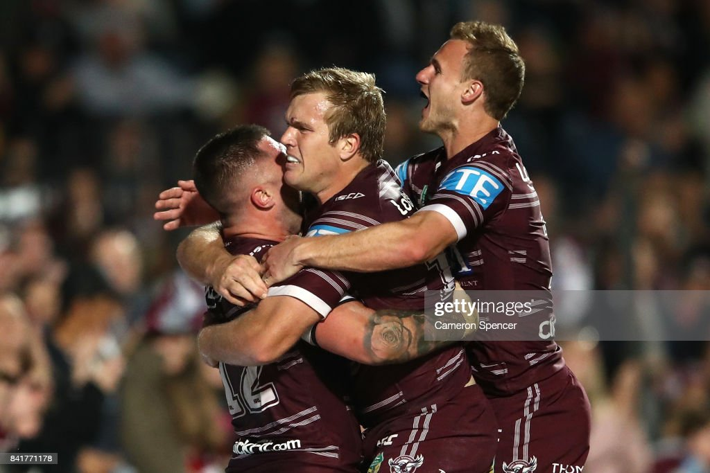 Curtis Sironen of the Sea Eagles celebrates scoring a try with team mates during the round 26 NRL match between the Manly Sea Eagles and the Penrith Panthers at Lottoland on September 2, 2017 in Sydney, Australia.