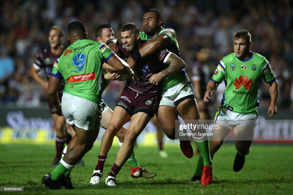 Curtis Sironen of the Sea Eagles is tackled during the round four NRL match between the Many Sea Eagles and the Canberra Raiders at Lottoland on March 31, 2018 in Sydney, Australia.