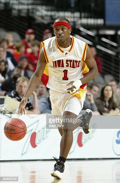 Curtis Stinson of the Iowa State Cyclones brings the ball upcourt during the Phillips 66 Big 12 Tournament game against the Kansas State Wildcats on...