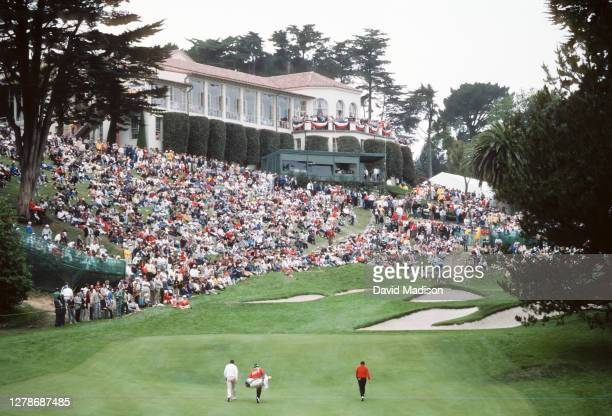 Curtis Strange of the USA ) and David Graham of Australia walk to the 18th green during the 1987 U.S. Open golf tournament held June 18-21, 1987 at...
