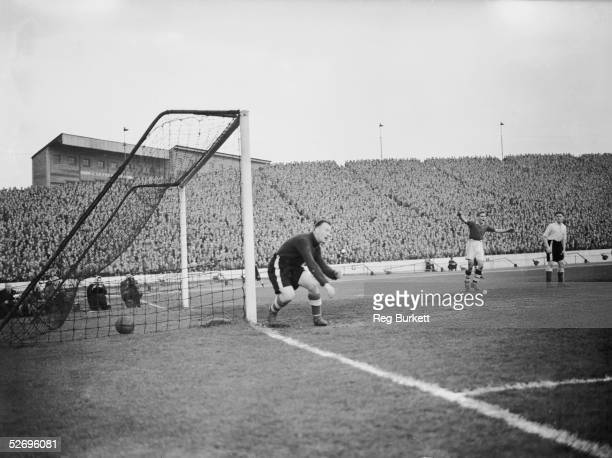 Curtis the substitute goalkeeper for Sheffield Wednesday fails to stop a shot from Parsons the Chelsea outsideright during a match at Stamford Bridge...