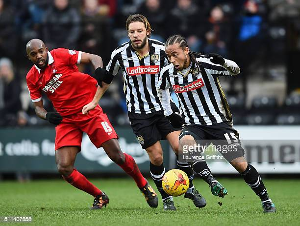 Curtis Thompson and Alan Smith of Notts County battle with Nigel Atangana of Leyton Orient during the Sky Bet League Two match between Notts County...