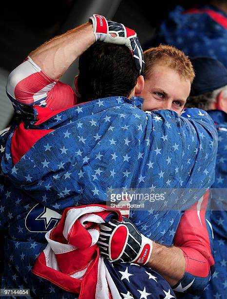 Curtis Tomasevicz of USA 1 celebrates with a teammate after winning the gold medal during the men's four man bobsleigh on day 16 of the 2010...