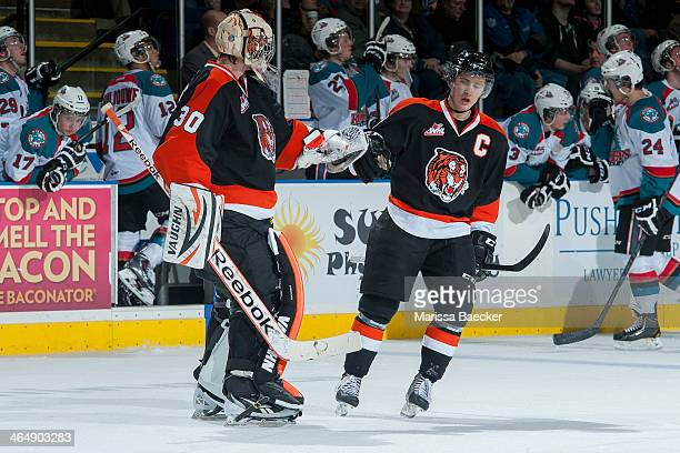 Curtis Valk and Marek Langhamer of the Medicine Hat Tigers celebrate a goal in the second period against the Kelowna Rockets on January 24 2014 at...