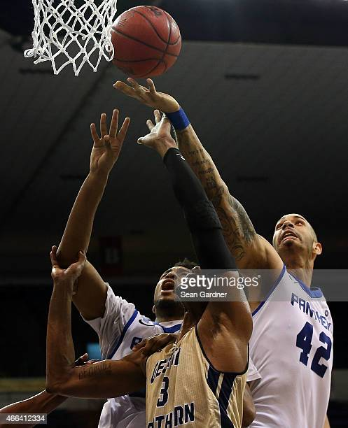 Curtis Washington of the Georgia State Panthers goes for a rebound with Eric Ferguson of the Georgia Southern Eagles during the Sun Belt Conference...