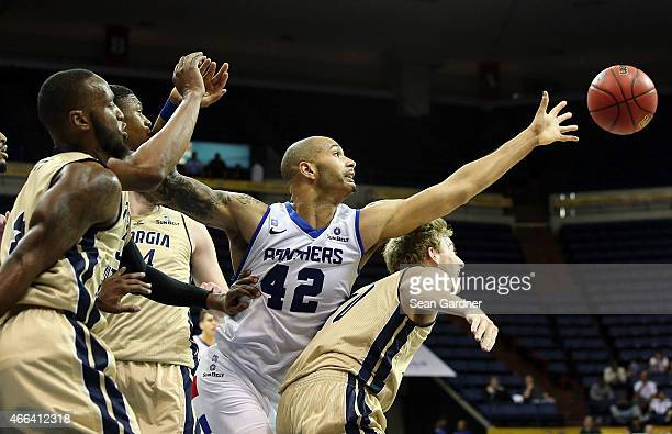 Curtis Washington of the Georgia State Panthers scrambles for a loose ball with Jake Allsmiller of the Georgia Southern Eagles during the Sun Belt...