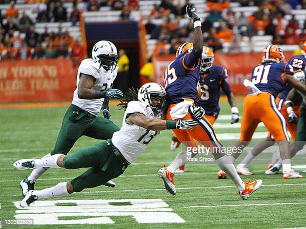 Curtis Weatherspoon of the South Florida Bulls tackled Jeremiah Kobena of the Syracuse Orange during the game at the Carrier Dome on November 11 2011...