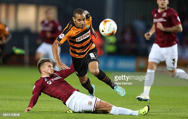 Curtis Weston of Barnet attempts to move past the challenge of Lawson D'Ath of Northampton Town during the Sky Bet League Two match between Barnet...