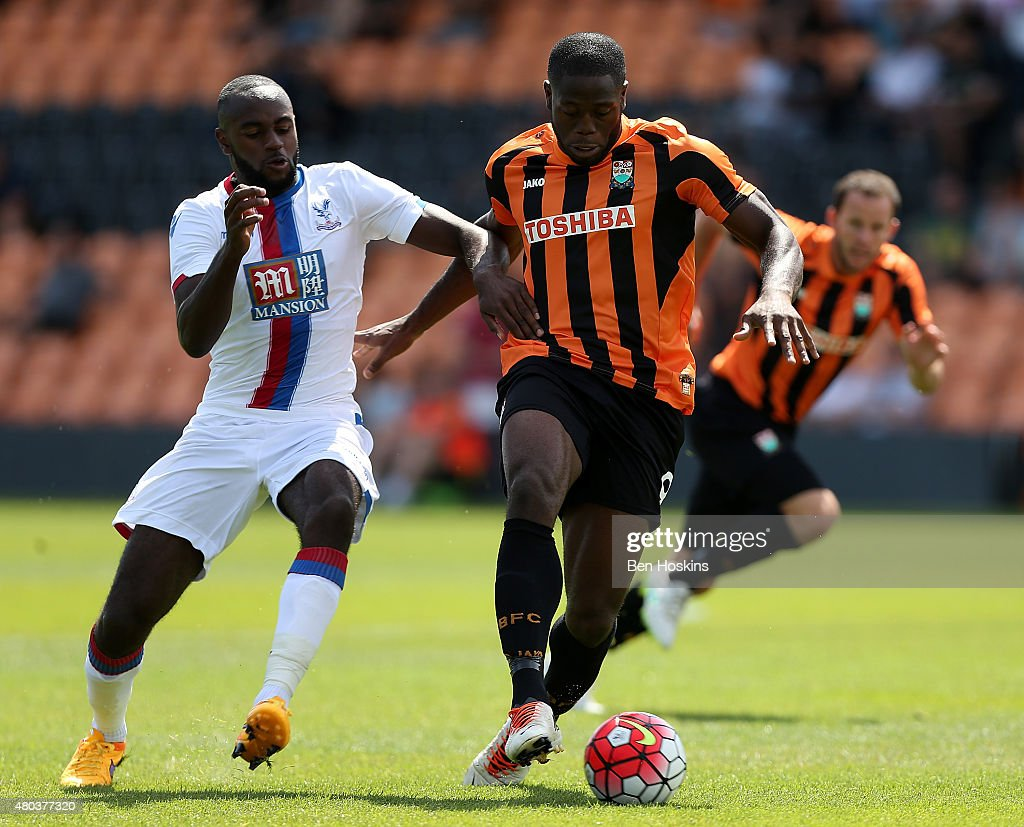 Curtis Weston of Barnet holds off pressure from Hiram Boateng of Crystal Palace during a Pre Season Friendly between Barnet and Crystal Palace at The Hive on July 11, 2015 in Barnet, England.