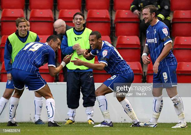 Curtis Weston of Gillingham celebrates his goal with team-mates during the FA Cup Second Round match between Leyton Orient and Gillingham at...