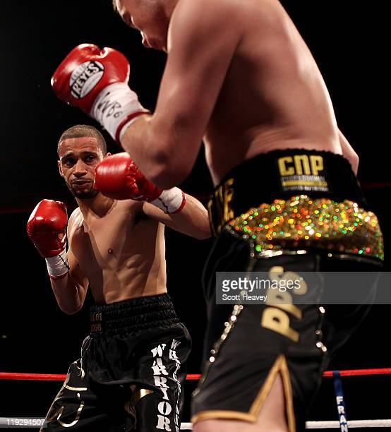 Curtis Woodhouse battles with Frankie Gavin during the WBO Intercontinental Welterweight Championship bout bout at Echo Arena on July 16 2011 in...