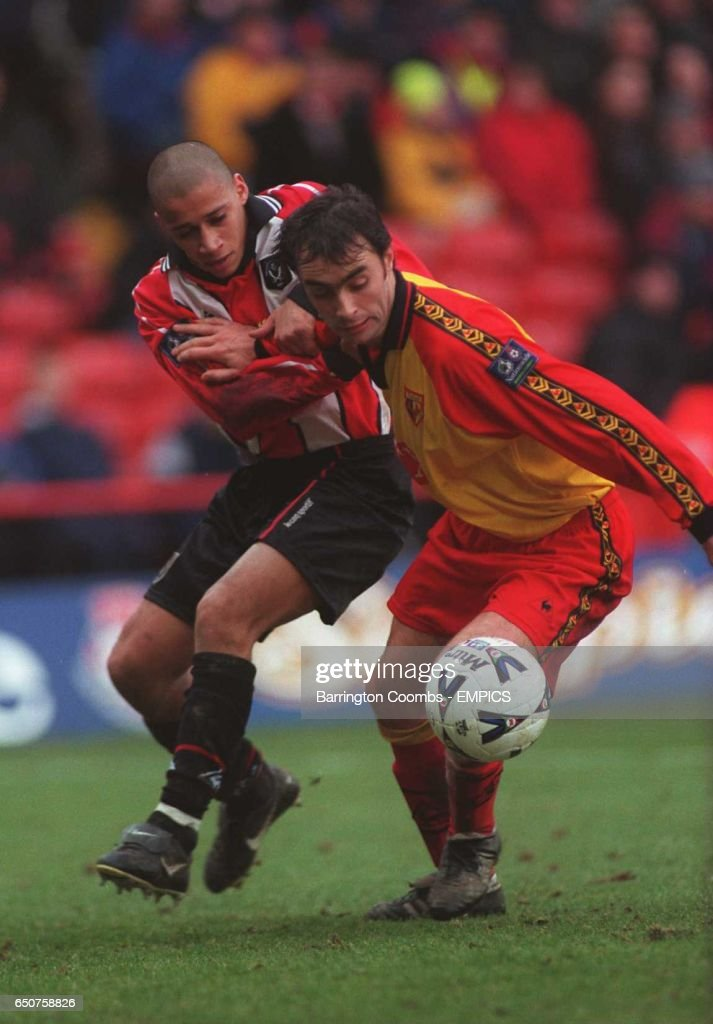 Curtis Woodhouse of Sheffield United (left) pulls back Darren Bazeley of Watford