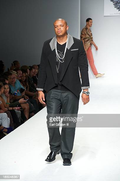 Curtis Young models for Michael Herrera's luxury streetwear line during LA Fashion Week on October 17 2013 in Los Angeles California