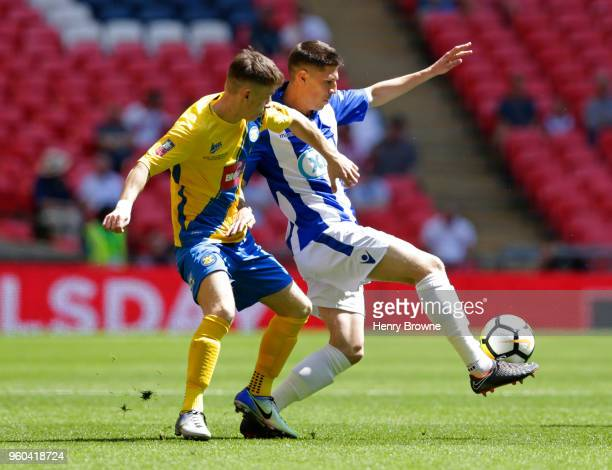 Curtiss Angell of Thatcham Town and Kevin Hayes of Stockton Town during the Builbase FA Vase Final between Stockton Town and Thatcham Town at Wembley...