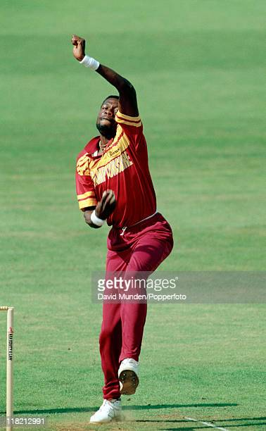 Curtly Ambrose bowling for Northamptonshire circa 1993