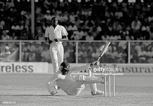 Curtly Ambrose unsettles Devon Malcolm with a bouncer, having bowled him with a no ball, 4th Test West Indies v England at Bridgetown 1989-90.