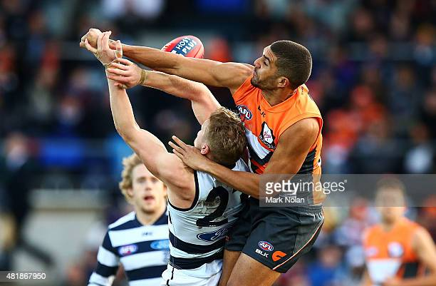 Curtly Hampton of the Giants and Josh Caddy of the Cats contest possession during the round 17 AFL match between the Greater Western Sydney Giants...