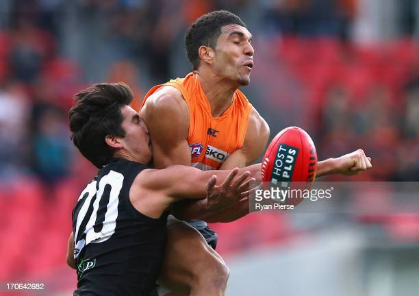 Curtly Hampton of the Giants is spoiled by Chad Wingard of the Power during the round 12 AFL match between the Greater Western Sydney Giants and Port...