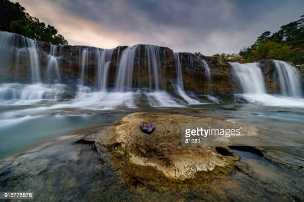 curug dendeng waterfall, tasikmalaya, west java, indonesia - falling water stock photos and pictures