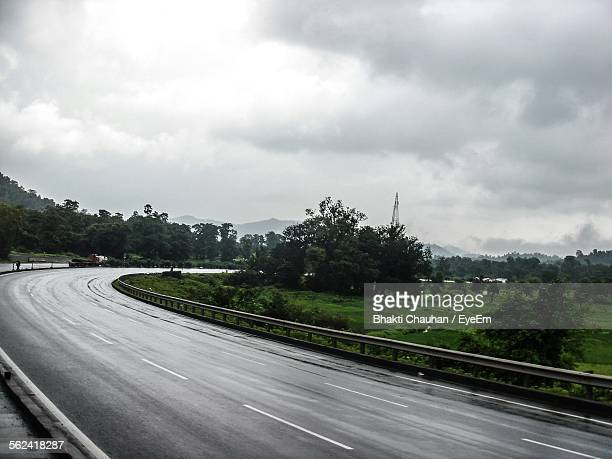 Curve On Highway Under Storm Clouds