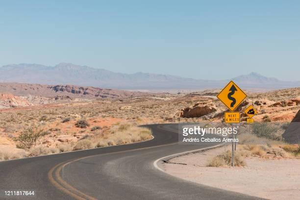 curve road crossing the desert - nevada bildbanksfoton och bilder