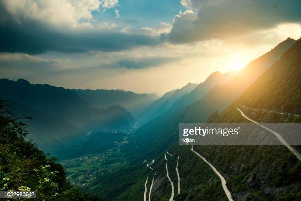 curve road in mountains - mountain road stock pictures, royalty-free photos & images