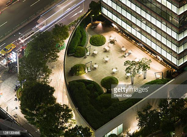 a curved balcony garden at dusk from the mori tower, roppongi hills, roppongi, tokyo, japan - roppongi hills stock pictures, royalty-free photos & images
