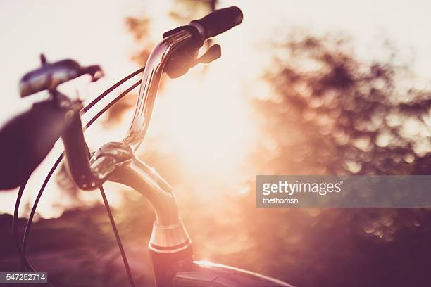 curved bicycle handlebar at sunset light - handlebar stock pictures, royalty-free photos & images