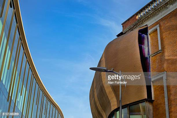 Curved brick addition to the Crawford Art Gallery, Cork, Ireland, designed by Dutch architect Erick van Egeraat contrasts with the older section of...