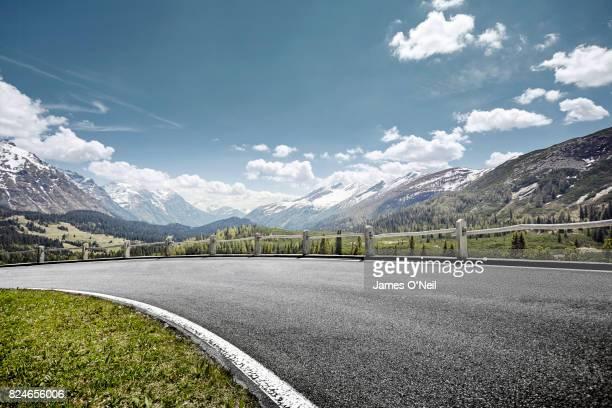Curved empty road on mountain pass, San Bernardino, Switzerland