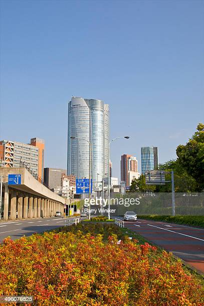 curved exterior of mori tower, tokyo - 六本木ヒルズ ストックフォトと画像