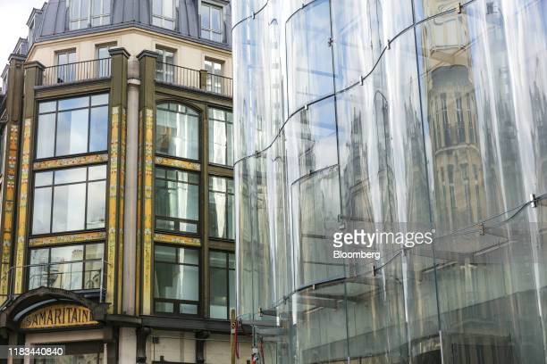 A curved glass facade covers the Samaritaine department store operated by LVMH Moet Hennessy Louis Vuitton during ongoing renovation work in Paris...