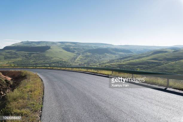 curved mountain road - country road stock pictures, royalty-free photos & images