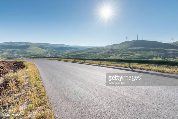 curved mountain road - hill stock pictures, royalty-free photos & images