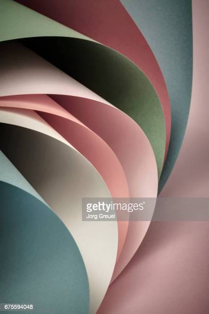 curved multicolored sheets of paper - kelly green stock pictures, royalty-free photos & images