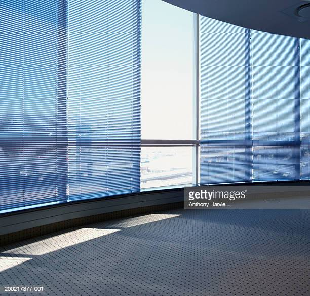 Curved office window with single blind up
