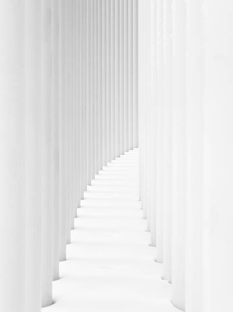Curved path between two rows of white pillars