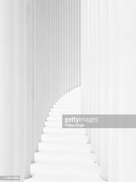 curved path between two rows of white pillars - luxembourg city luxembourg stock photos and pictures