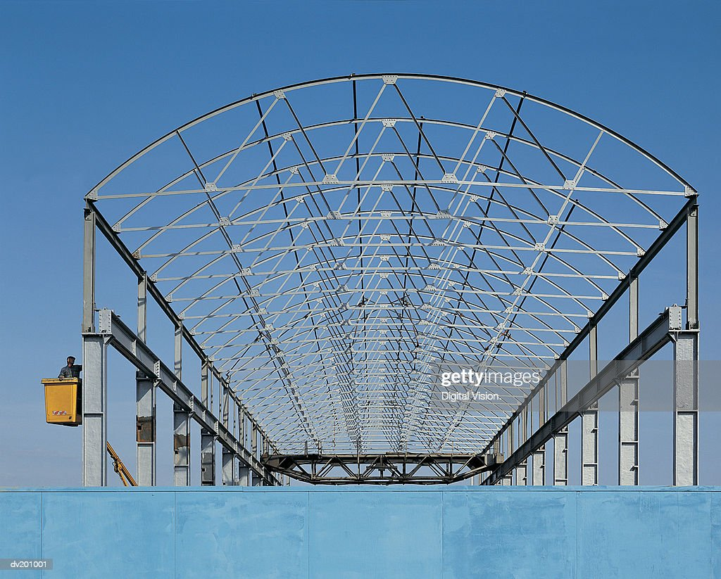 Curved rafters against sky : Stock Photo